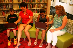 A preview: 5th graders Hunter Davis (left) and Carolina Cooper were able to get a first-hand feel for the Chromebooks when they stopped by the elementary school this summer. Show with the students is (left) 5th grade teacher Tami Clark and Intermediate Principal Karen Bullock (right).