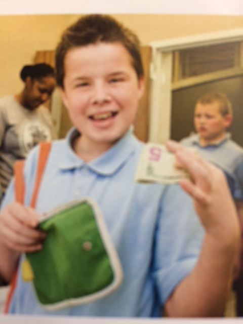 Students make a $12 withdrawal at the Huntington Bank and put their cash in the provided wallets.